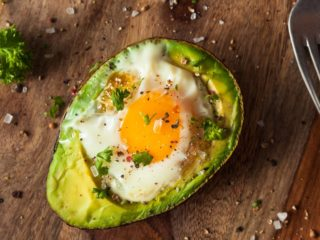 A picture of homemade Organic Egg Baked in Avocado with Salt and Pepper.